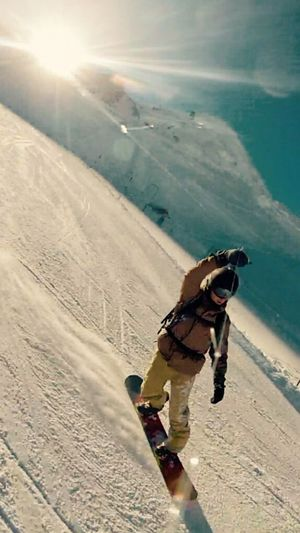 Full length of man standing on snow covered landscape