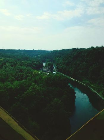 Under the bridge Sky Nature Tree High Angle View Tranquility Scenics Tranquil Scene Landscape Beauty In Nature Outdoors Day River Water Forest No People Mountain House EyeEmNewHere Bridge View