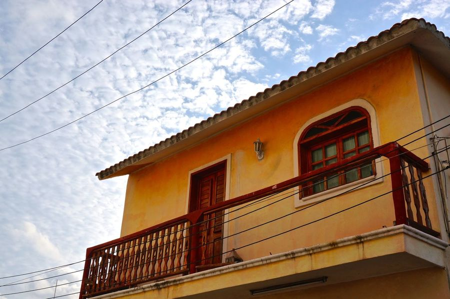 Architecture Bad Condition Building Building Exterior Built Structure Cable Cloud - Sky Cloudy Damaged Day Fresh On Eyeem  High Section Low Angle View Mexico No People Orange Outdoors Power Line  Residential Building Residential Structure Rustic Sky Weathered Window