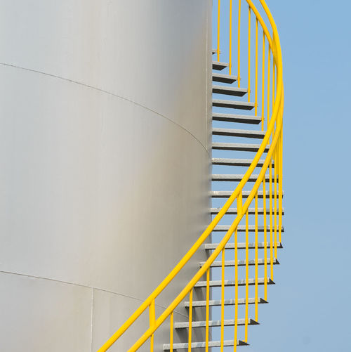 Yellow staircase against sky
