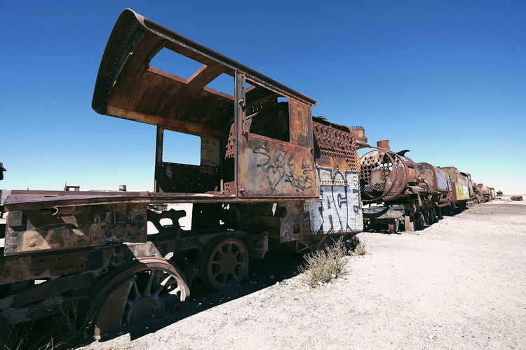 Train Cemetery Train Train Cemetery Abandoned Rusty Desert No People Adventure Blue Sky Bolivia Graffiti Sunny