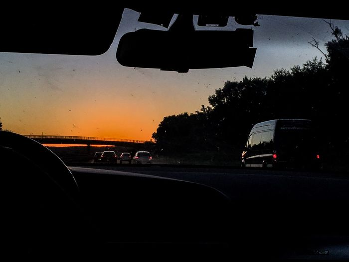 Traffic on road seen through car windshield