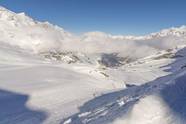 Missing the cold Naturephoto Snow Cold Switzerland Mountain Ridge Mountain Peak Foggy Valley Ski Track Ski Lift