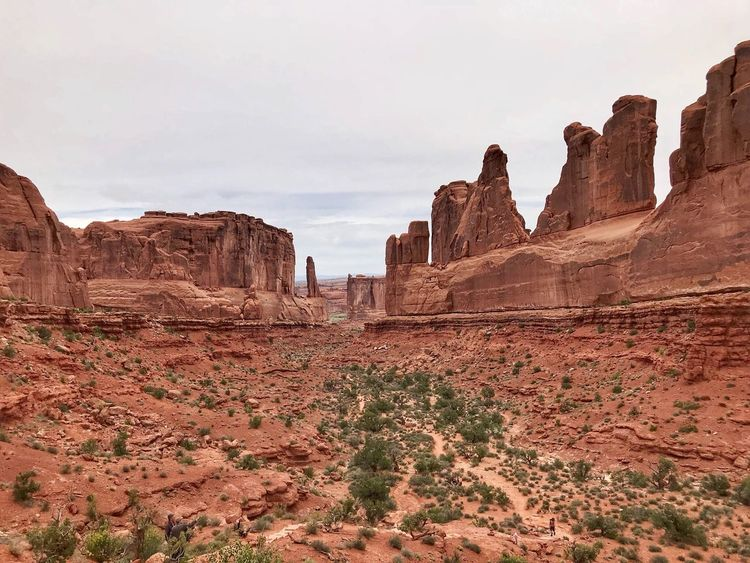 Landscape at Arches National Park of Massive vertical rock formations in a line Arches National Park, Utah Sky Nature Rock Land Day Solid Rock - Object Rock Formation No People Architecture Environment Plant Travel Destinations Landscape Scenics - Nature Tranquility Ancient