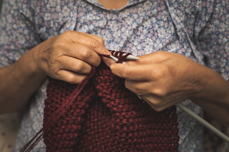 Midsection Of Woman Knitting Wool