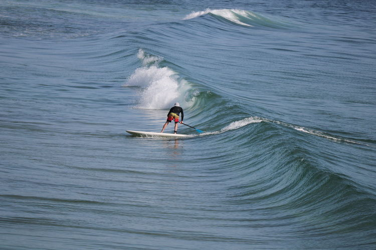 ocean to ourselves Second Acts Adult Adventure Aquatic Sport Beauty In Nature Day Extreme Sports Full Length Leisure Activity Lifestyles Men Nature One Man Only One Person Only Men Outdoors Paddleboarding Real People Sea Skill  Sport Surfboard Surfing Water Wave