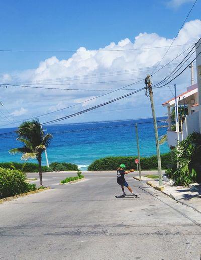 Slide it down Sea Longboard Longboarding IslaMujeres Mexico Skateboarding Streetphotography Fujifilm_xseries FUJIFILM X-T2 Fujifilm First Eyeem Photo NewEyeEmPhotograph Street Road Sea And Sky Island Mexican EyeEmNewHere EyeEmNewHere Go Higher