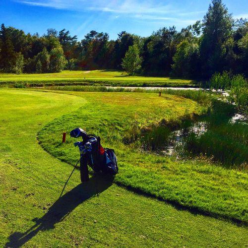 Golf bag on field