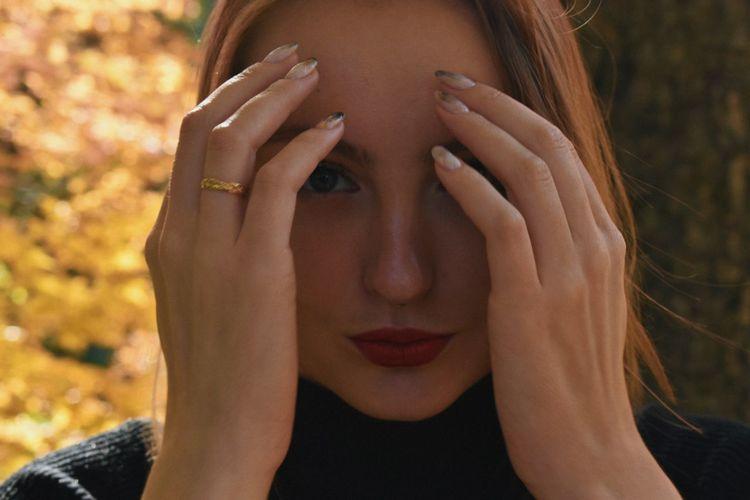 Close-up portrait of woman hands