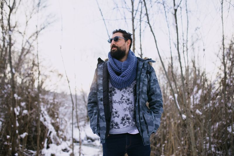 Winter One Person Cold Temperature Clothing Lifestyles Young Adult Snow Front View Facial Hair Plant Nature Tree Leisure Activity Real People Standing Young Men Warm Clothing Beard Land Scarf
