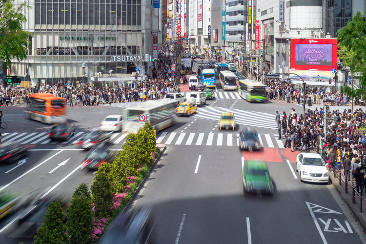 Pedestrians walk at Shibuya Crossing. Shibuya is a popular disctict in Tokyko with fashionable brands. This is a very busy district. Bus Business City Life City Street Day Diminishing Perspective District Land Vehicle Landmark Mode Of Transport On The Move Outdoors Parking Parking Lot Pedestrian Road Road Marking Shibuya Taxi The Way Forward Traffic Traffic Jam Transportation Travel Destinations Vehicle