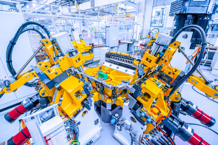 Low angle view of yellow machinery in factory