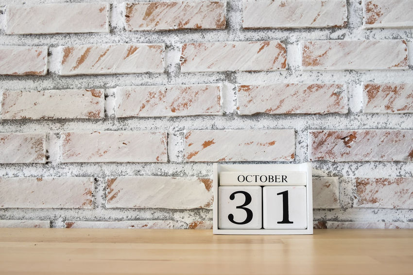 October 31th. Image of October 31 wooden color calendar white brick wall background. Autumn day. Empty space for text 31 October Architecture Autumn Brick Wall Communication Concrete Day October Outdoors Text Wall - Building Feature Western Script Wood