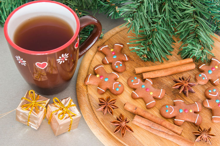 High angle view of gingerbread cookies and spices on table