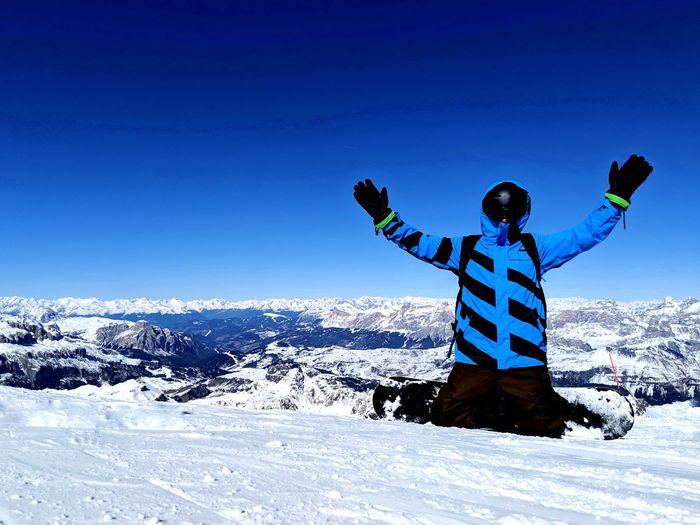 My brother checking out this Marmolada thing Warm Clothing Snowboarding Clear Sky Snow Ski Holiday Cold Temperature Winter Mountain Adventure Blue Ski Jacket Ski-wear Ski Resort  Deep Snow Winter Sport
