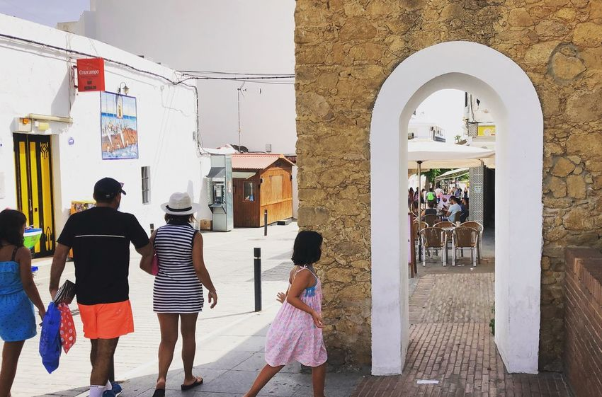 Go the fun way Cadiz Conil De La Frontera Fun Path SPAIN The Street Photographer - 2018 EyeEm Awards Tourists Youth Arch Architecture Beachgoers Built Structure Casual Clothing City Daughter Day Family Girl Group Of People Kid Leisure Activity People Real People Street Walking