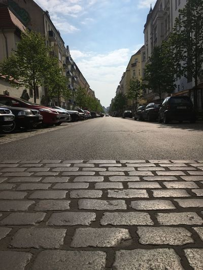 View of street in city against sky