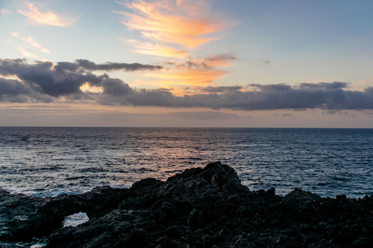 Sunrise over the Atlantic Ocean from Fuencaliente, La Palma with volcanic igneous rocks in the foreground Sea Sky Water Horizon Over Water Scenics - Nature Horizon Beauty In Nature Cloud - Sky Tranquility Sunset Beach Land Tranquil Scene Nature No People Idyllic Rock Non-urban Scene Wave Outdoors Fuencaliente Fuencaliente De La Palma La Palma, Canarias Sunrise La Palma Island