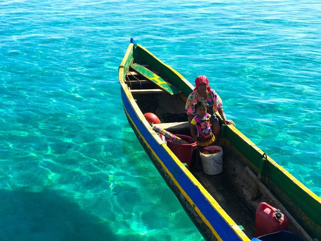 Locals around the San Blas islands SanBlasIslands Islands Fisherman Fisherman Boat Family Locals Caribbean Water Nautical Vessel Transportation Mode Of Transportation Sea High Angle View Nature Sunlight Day Turquoise Colored Waterfront Real People Blue Travel Beauty In Nature