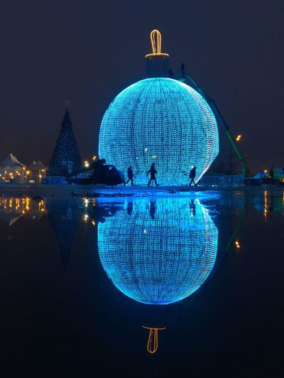 The largest Christmas sphere in Moscow, final strings of lights being attached Reflection Illuminated Night The City Light Night Photography Christmas Streetphotography Night Illumination Christmas Decorations Round Lights Reflections Street Reflections Night Reflections Reflection Christmas Decoration Night Lights Dome Blue Water Architecture Travel Destinations Outdoors Crystal Ball Building Exterior Luminosity