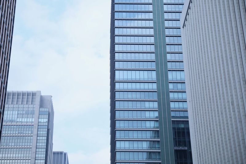 Built Structure Architecture Building Exterior Building Office Office Building Exterior City Sky Low Angle View Modern Glass - Material Cloud - Sky Window No People Day Skyscraper Nature Outdoors Reflection Tall - High Financial District