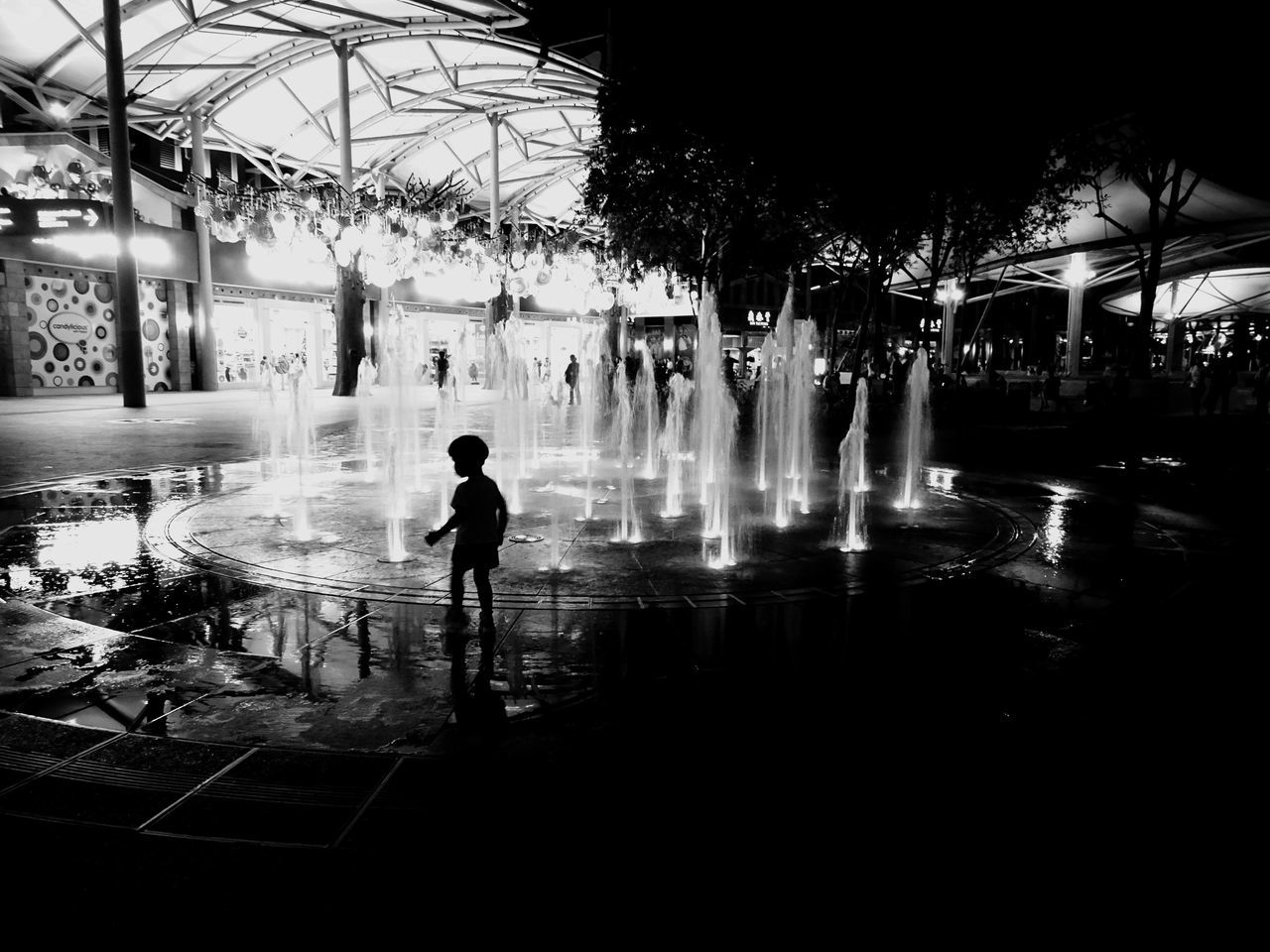 real people, water, night, architecture, one person, full length, building exterior, built structure, lifestyles, reflection, outdoors, leisure activity, illuminated, swimming pool, men, tree, boys, city, people, adult