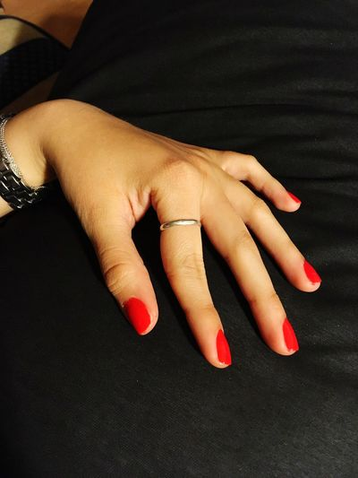Close-up of woman hand with red nail polish in fingernails