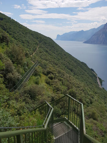 Sentiero Busatte-Tempesta Gardasee Green Green Color Italia Stairs Stairway Architecture Beauty In Nature Bridge Bridge - Man Made Structure Built Structure Cloud - Sky Connection Day Environment Garda Lake Gardalake Italy Italy❤️ Landscape Mountain Nature No People Non-urban Scene Outdoors Plant Railing Scenics - Nature Sky Stairs Geometry Stairs_collection stairways Tranquil Scene Tranquility Tree Water