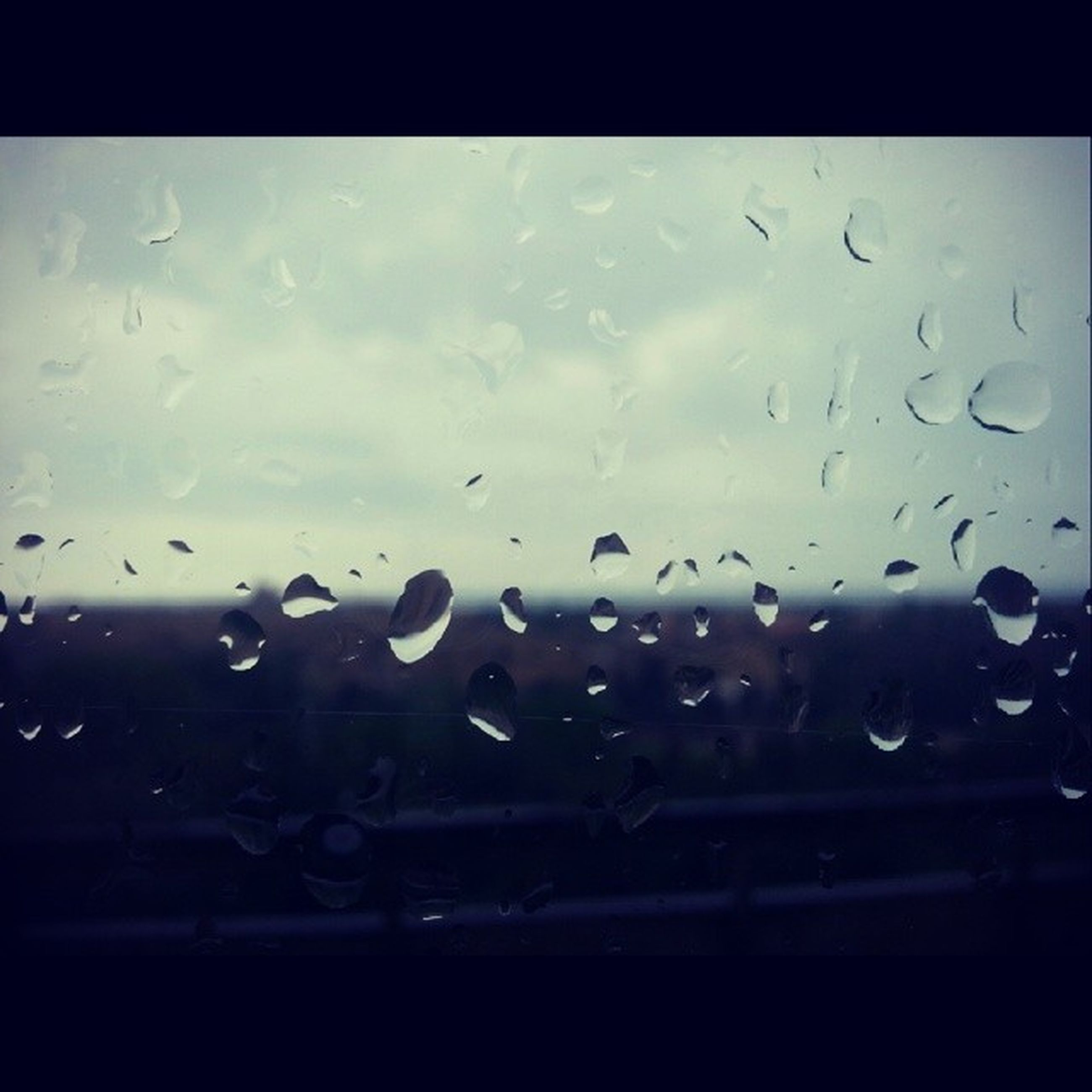 drop, window, wet, transparent, water, glass - material, rain, sky, indoors, raindrop, weather, transportation, car, glass, mode of transport, vehicle interior, silhouette, focus on foreground, land vehicle, nature
