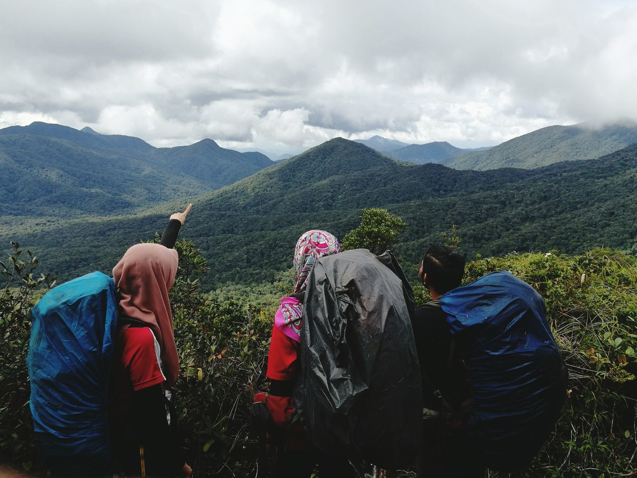 real people, backpack, mountain, hiking, rear view, landscape, sky, outdoors, nature, adventure, field, day, men, cloud - sky, lifestyles, mountain range, togetherness, women, scenics, beauty in nature, grass, friendship, people