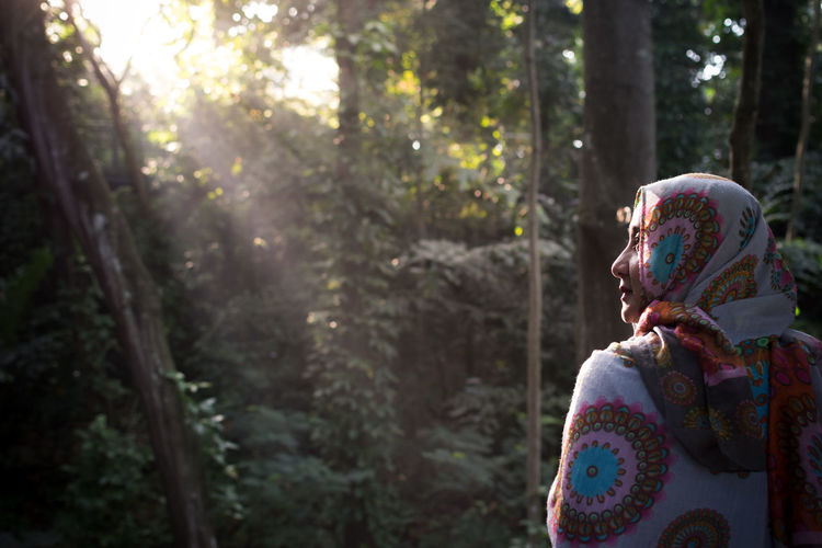 Woman Wearing Hijab While Standing In Forest