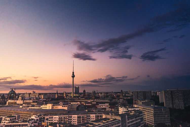 Berlin from above I Architecture Berlin Blue Built Structure Capital Cities  City City Life Cityscape Cloud Cloud - Sky Cloudy Communications Tower Evening Illuminated Modern No People Orange Color Outdoors Residential Building Residential District Sky Sunset Tall - High Television Tower Travel Destinations