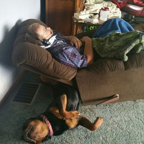 My husband just home from the hospital and our 11 month old rottweiler Tank wanted to be close to him. Taking Photos Relaxing Animals Sleepy Injury Accident Hurt Rottweiler Rottweilerinstagram Rottweilerlove