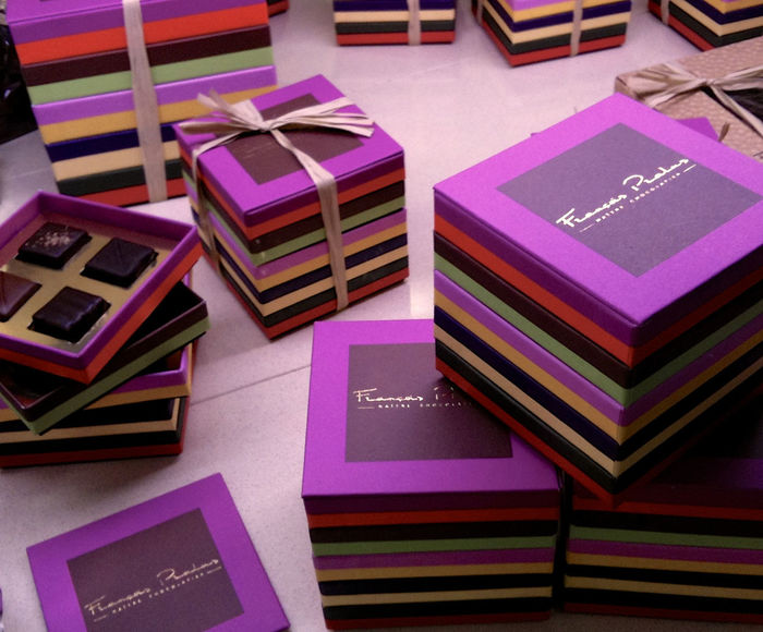 Arrangement Chocolate Close-up Day Delicious High Angle View Indoors  Indulgence Large Group Of Objects Multi Colored Multicolored No People Pink Color Pralus Presentation Background Purple Colors Shapes And Forms Square Shape Stack