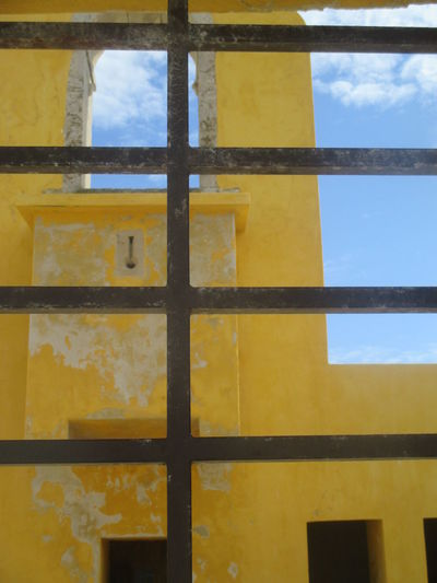 Architecture Backgrounds Close-up Day Decay Destruction Force Full Frame Lack Of Freedom Loneliness Metal Grate Monument No People Old Buildings Old Fortress Old Wall Outdoors Peniche Fortress Peniche Portugal Prison Security Bar Sky Window Yellow Yellow Wall