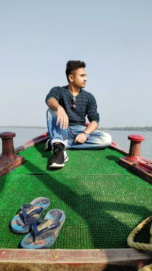 Self Portrait - IV Handsome Boy Sundarbans Sundarban Diaries Sundarban National Park Portrait Portrait Photography Portrait Of A Man  Fashion Photography Fashion Style And Fashion Style Stylish Stylish Man Young Men Boat Man On Boat Flipflops Causal Clothing Looking Far Away Clear Sky Full Length Sky Grass Shore Horizon Over Water Ocean Seascape Sea Beach Calm Go Higher This Is Queer