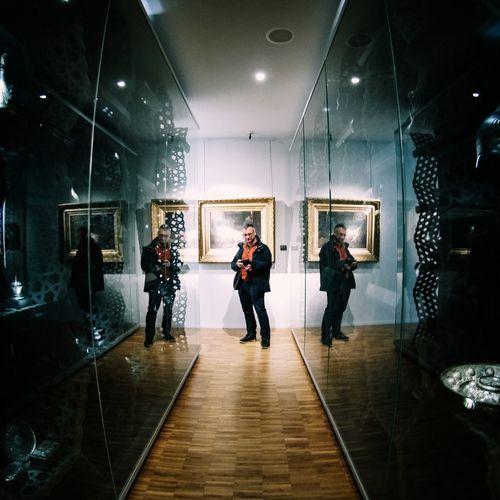 People standing in illuminated corridor
