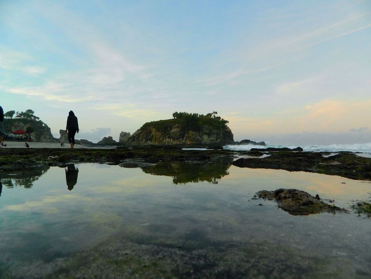 Sky Reflection Nature Rock - Object Water Tranquility One Person Tranquil Scene Outdoors Cloud - Sky Scenics Sea Beauty In Nature Day Beach Landscape Klayarbeach Pacitan EyeEm New Here