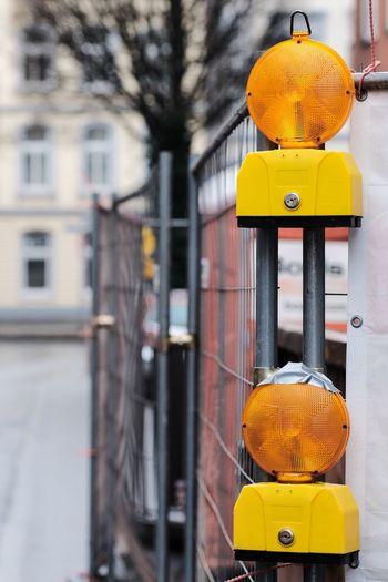 Close-up of road reflectors on metallic gate