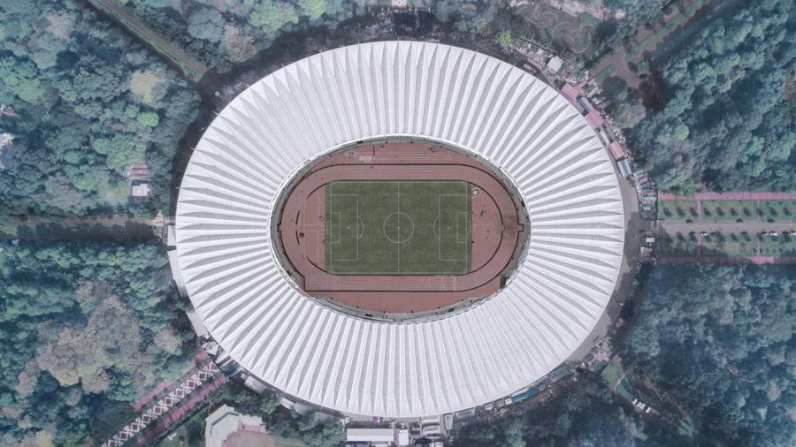 Directly above shot of soccer stadium and trees