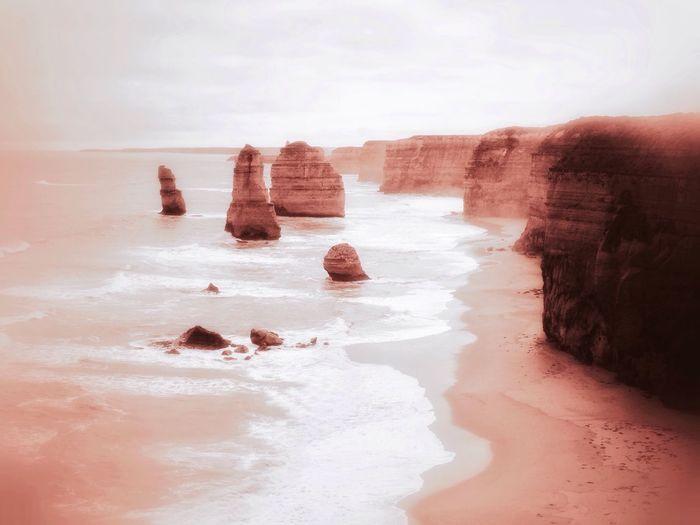 Scenic view of twelve apostles sea rocks against sky