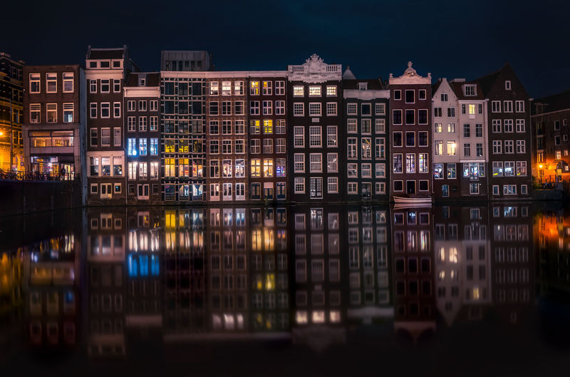 Amsterdam Dutch Holland Remo SCarfo Reflection EyeEm Best Shots EyeEmNewHere EyeEm Selects Night Illuminated Building Exterior Architecture Built Structure Building City No People Water Waterfront Residential District Outdoors Travel Destinations Nature Multi Colored Window Glowing Canal Apartment Row House
