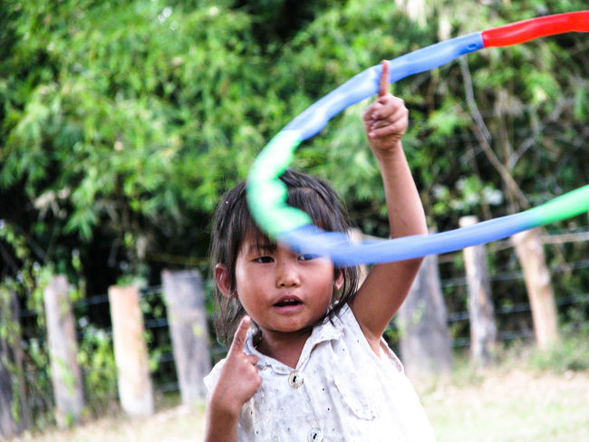 EyeEmNewHere Casual Clothing Childhood Day Focus On Foreground Fun Hula Hooping  Leisure Activity Lifestyles One Person Outdoors Real People School Yard Tree