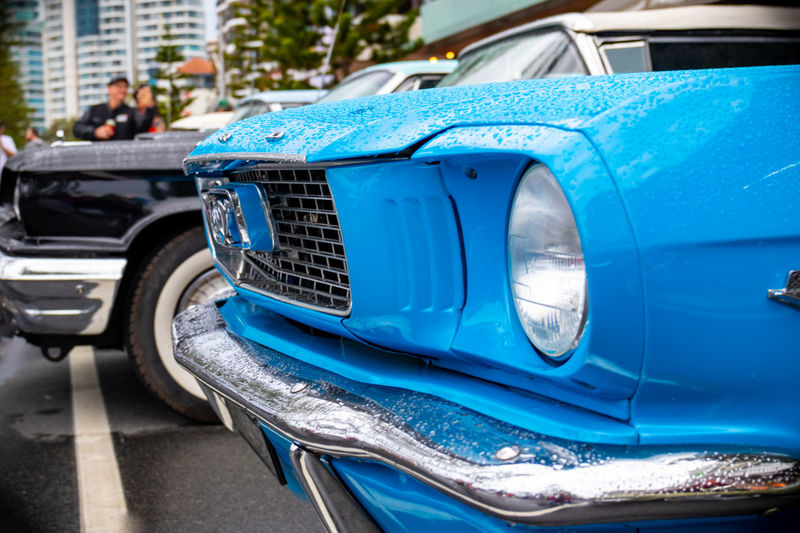 Close-up of blue car in city