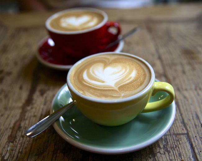 Love the cappuccinos in Spain. Coffee Coffee - Drink Mug Cup Coffee Cup Drink Food And Drink Refreshment Cappuccino Hot Drink Frothy Drink Crockery Spoon Saucer Latte Froth Art Wood - Material Eating Utensil Kitchen Utensil Table No People Caffeine Teaspoon Non-alcoholic Beverage Wood Grain