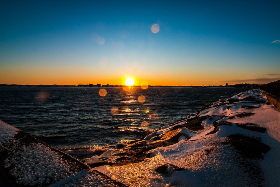 Sunsets are my favorite, even in -15 degrees temps Sunset Moon Beauty In Nature Nature Sun Scenics Sky Sea No People Tranquil Scene Tranquility Water Sunlight Outdoors Clear Sky Astronomy