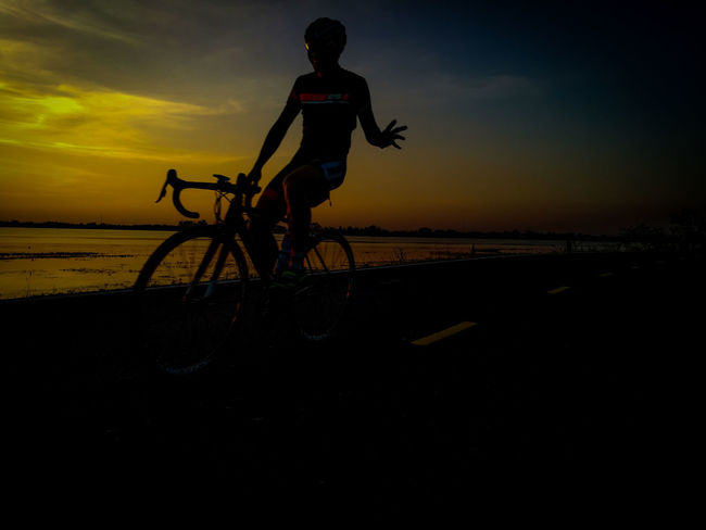 Bicycle Sunset Cycling Mode Of Transport Silhouette Sky Beauty In Nature Transportation People Nature One Person Full Length Outdoors Adult Scenics Adults Only Men Adventure Only Men Night Surin Thailand Cyclingphoto Clinging To Life RhinoSurinCyclingClub