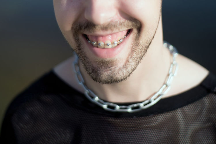 Close-up portrait of a smiling young man