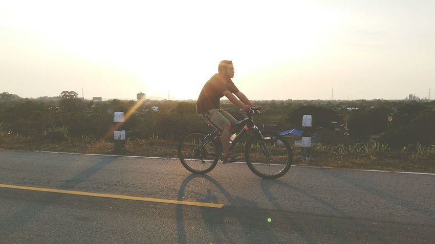 Sunlight Only Men Healthy Lifestyle Leisure Activity Riding Cycling Sunset Transportation Adventure Road Mode Of Transport Wheel Exercising Sport Outdoors Bicycle Sporty One Person