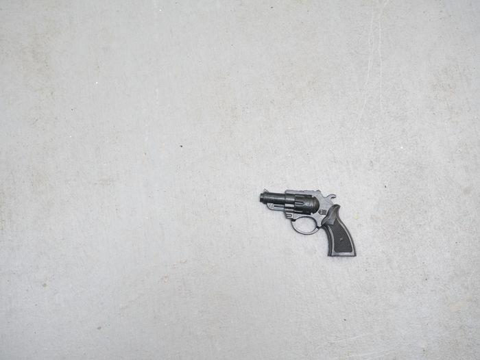 Close-up of handgun with white background
